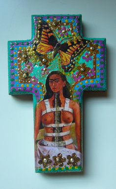 Frida and butterfly on wooden cross
