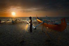 a boy on sunrise by dody herawan on Belitung, Sunrise, Boys, Baby Boys, Children, Sunrises, Senior Guys, Sunrise Photography, Rising Sun