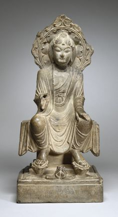 Deity: Maitreya (The Buddha of the Future) Country: China Date:1st quarter 8th century Medium: Carved Stone Mudra: This sculpture of seated Maiteya is missing a right arm which could have been raised in a Vitarka Mudra which is representative of spiritual guidance.