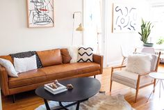 The Axel Leather Sofa steals the show in this Artist's apartment!