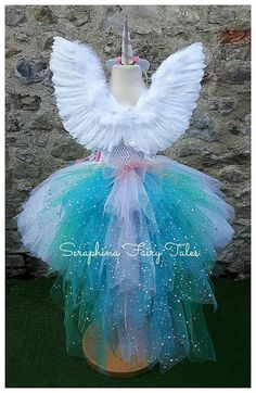 **PLEASE NOTE MY CURRENT TURNAROUND TIME IS 2-3 WEEKS FROM ORDERING. PLEASE CONTACT ME BEFORE PURCHASING TO CONFIRM DATE NEEDED BY.** This beautiful handmade tutu dress is made with hundreds of metres of super soft tulle, a little bit of magic & lots of fairy wishes making them