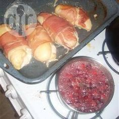 Garlic-stuffed chicken breasts are wrapped with prosciutto, roasted until the prosciutto is crispy, then served with a orange-cranberry jus. This impressive dish is delicious and goes especially well with roasted potatoes, broccoli and baby carrots. Ham Wraps, Chicken Wraps, Baked Chicken, Stuffed Chicken, Prosciutto Wrapped Chicken, Chicken Finger Recipes, Glass Baking Dish, Boneless Chicken, Roasted Potatoes
