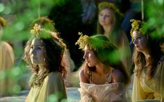 "Young women dressed as summer fairies attend an event inspired by pre-Christian traditions in Bucharest, Romania, on June 23, 2013. According to tradition, fairies, called in Romanian ""Sanziene"", come to earth around the summer solstice bringing fertility for the coming summer. (AP Photo/Vadim Ghirda)"