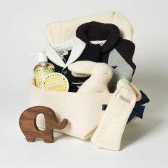 Star light star bright – Bonjour Baby Baskets This very exclusive baby basket features two Armani Junior bodysuits in coordinating colors and a wonderful and soft blanket by Austrian designer David Fusseneger. http://bonjourbabybaskets.com/products/star-light-star-bright