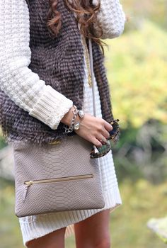 Fur vest over sweater dress