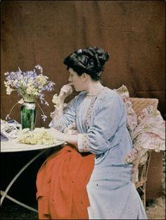 Henrie Chouanard - Seated Woman with a Vase of Flowers