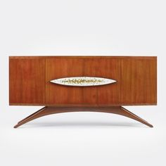 Vladimir Kagan  cabinet        Kagan-Dreyfuss, Inc.USA, c. 1953 cherry, glass tile 66 w x 18 d x 32 h inches Four doors conceal four adjustable shelves and six drawers. v10