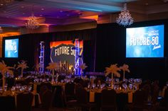 Color-changing LED uplighting, stage wash, lucite podiums, PA system, intelligent lighting, truss, custom gobo projection of sponsor logos, high-output (high lumen) projectors and screens for a corporate awards banquet. Audio/visual production and lighting by Synergetic Sound + Lighting: www.synergeticsounds.com
