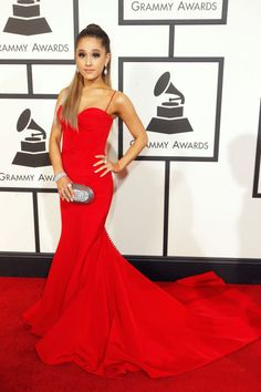 Ariana Grande picks a regal red Romona Keveza gown for the 2016 Grammys.