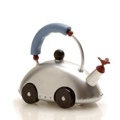 """Whistling Bird Tea Kettle Car. """"It was the first product by an American designer to be included in the Alessi catalog."""" """"It was inspired by Post- modern and Pop- Art design, and has been an Alessi best seller since 1985."""""""
