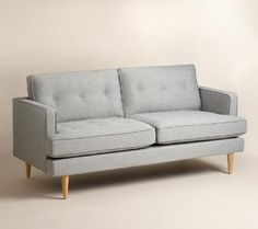 A clean silhouette, tufted detailing and tapered Danish-inspired legs give our sofa a wealth of mid-century style. Crisp light gray woven upholstery adds to its classic appeal, with reversible cushions to extend the life of the piece. Tufted Couch, Upholstered Daybed, Sofa Beds, New Living Room, Living Room Furniture, Living Room Decor, Living Spaces, White Leather Sofa Bed, Cheap Sofas