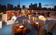 Sky Bar in Toronto overlooking the downtown skyline and Lake Ontario. Hg2.com