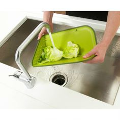 Fold-able cutting board that doubles as a colander - Rinse™ Plus by Joseph Joseph