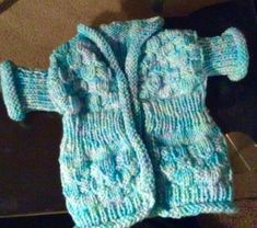 """""""Icy skies"""" baby's jacket. Cute pale blue and white baby's jacket with a wintry name but a summery feel!  Short sleeves; cute painted wooden bird single button fastening. The yarn is in shades of pale blue, and while - as the name suggests - its initial impression is of icy pale blue, there's green-blue and mauve-blue as well as aqua and white. Blue Green, Blue And White, Angela White, Wooden Bird, Hand Knitting, Short Sleeves, Stockings, Mauve, Brother"""
