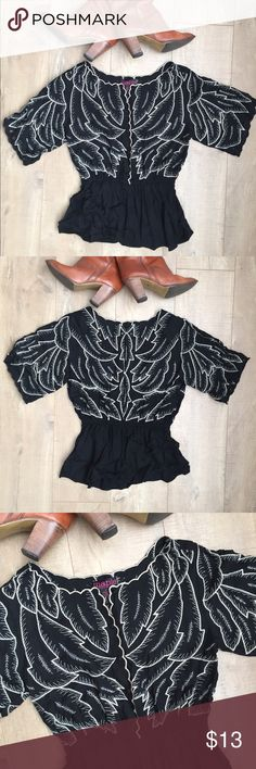 Embroidered Cut Out Top Button up top with cream leaf detail & flouncy waist. Gorgeous cut outs around the top (photo 4), ultra fun & fancy! Excellent condition! Maple Tops Blouses