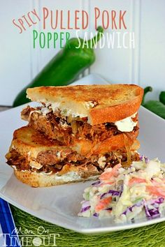 Spicy Pulled Pork Popper Sandwich recipe is made with my favorite slow cooker pulled pork recipe, caramelized onions, and Spicy Jalapeño cream cheese .