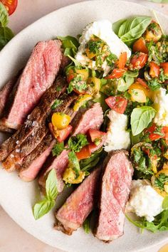 Juicy, chargrilled Steak Tagliata served with a fresh, bright and zingy tomato, herb salad with creamy buffalo mozzarella cheese. If you're looking for a fresh and delicious way to serve steak that's perfect for summer, this is it!