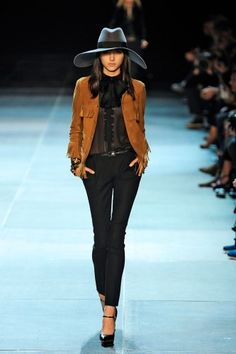 SoCal meets Paris at Yves Saint Laurent! love the hat and black skinnies.