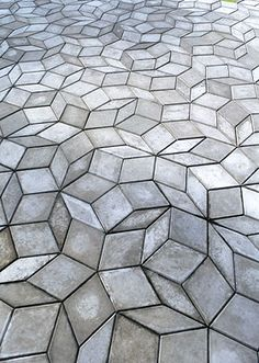 Penrose. One of my favorite things. It tessellates but doesn't have a repeating pattern -- blows my mind. I want it as a bathroom floor or something. These look like cement tiles. I should get on figuring out how to make them.