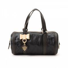 bc12119d6db LXRandCo guarantees this is an authentic vintage Gucci Gucci handbag.