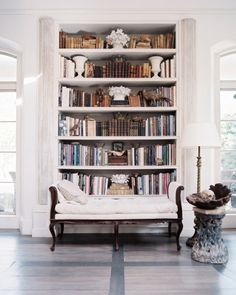 Bookshelf+between+balcon+doors+make+this+space+an+elegant+home+library