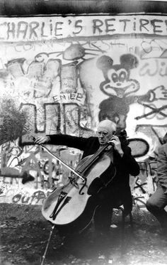 Mstislav Rostropovich plays his cello at the Berlin Wall, 1989