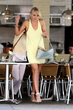 Cameron Diaz wears a yellow summer dress and open toed heels as she films a scene for 'The Other Woman' with Leslie Mann in NYC. The pair seemed to be having an argument as they left a restaurant with Leslie trying to block Cameron as she walked out.