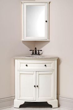 corner vanity and matching corner mirror for downstairs bathroom (Hamilton -- in distressed white) Bathroom Corner Cabinet, Bathroom Sink Vanity, Downstairs Bathroom, Bath Vanities, Bathroom Wall, Bathroom Storage, Corner Sink Bathroom Small, Corner Vanity Sink, Corner Medicine Cabinet