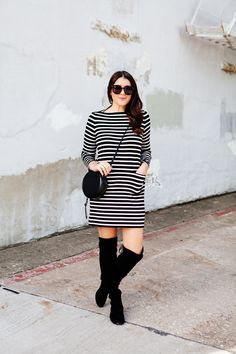 Striped everyday dress with over the knee boots on Kendi Everyday.