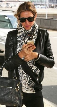 Gisele Bundchen travels in style with this Roberto Cavalli scarf.
