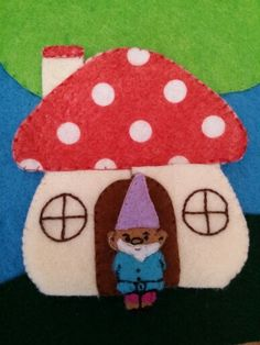 Cute little toadstool house and gnome resident. I didnt use a pattern but they were super easy. At my daughter's insistence, it is made so the doors open and there is a pocket inside. I made another one that isnt sewn down and included a back pocket on that one also.