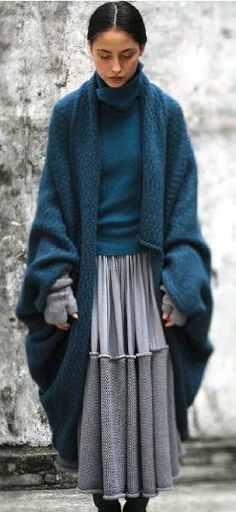 OK if I could look this good in a hand-crocheted skirt and  blanket-sweater....I'd wear this everyday during winter...in NORWAY!