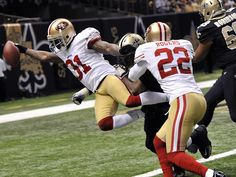 American football - San Francisco 49ers strong safety Donte Whitner (31) scores on a touchdown run in the second half of an NFL football game against the New Orleans Saints in New Orleans, Sunday, Nov. 25, 2012. (AP Photo/Bill Feig)(1280×960)