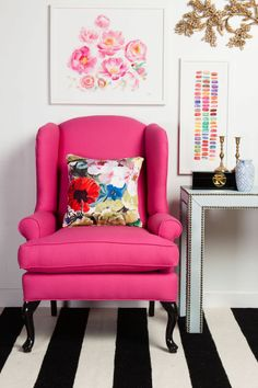 pink arm chair, striped carpet and cute wall art