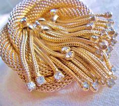 Vintage Hattie Carnegie Rhinestone Mesh Gold Tone Brooch Jewelry. $60.00, via Etsy.