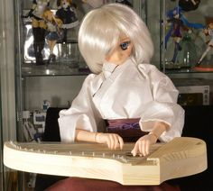 kotori018 | Eliza playing a traditional finnish instrument, … | Flickr