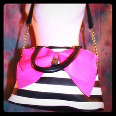 Ivory black off white striped hot pink bow satchel This fun & stylish Shoulder Bag Purse by Betsey Johnson can be worn on the wrist or as a shoulder bag. Features stripe details with fuchsia magenta bow decor with signature gold logo engraved on lock, gold chain accents on shoulder strap. Overall great condition with the exception of white rub off scuffing on back as shown in photo. Barely used. Measures 15 x 9 x 5.Firm price unless bundled  Betsey Johnson Bags Shoulder Bags