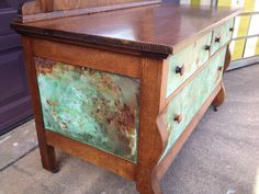 We've added our signature finish of Copper/Rust Patina to a tiger-oak dresser on the drawer fronts and side panels.