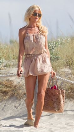 Beach babe: Victoria Silvstedt was seen showing off her slender physique on yet another day of fun in the sun