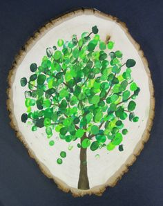 "This is so pretty! Tu B'shvat ""Fingerprint Tree"" group project on a large tree ring - or canvas"