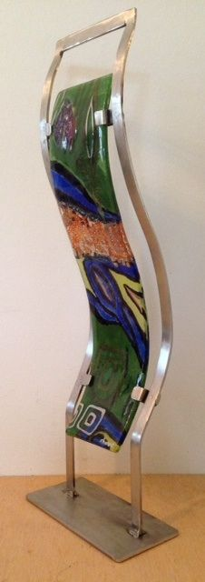 Fused glass and metal pigments. Stainless steel base