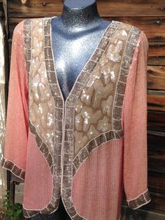 This gorgeous hook front blouse is in good vintage condition. four sequins are missing off of the back (pictured) I have repaired the thread https://www.etsy.com/listing/293848177/vintage-light-pink-and-tan-gorgeous?ref=shop_home_active_4 #sequins #dragrace #vintagesequins