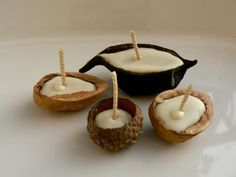 Walnut shell or acorn cap beeswax candles, can float in water from the magic onions