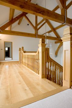 Beautiful craftsmanship is displayed on this bespoke timber balustrade on the balcony-style first floor landing of this home.