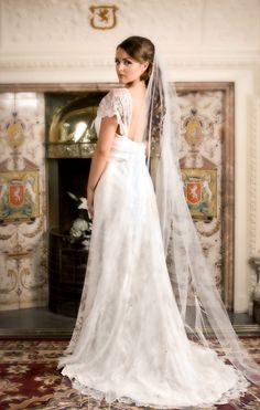 Backless lace wedding dress designed by Sarah Willard Couture