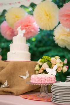 A soft and sweet butterfly garden-themed birthday! Love the ruffle smash cake! #firstbirthday