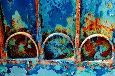 Blue, teal and orange rusty gate...
