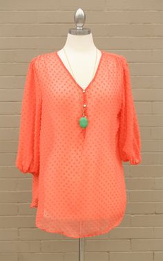 Curve~The Coral Dotted Chiffon Blouse - This dotted top is adorable! Add some sass to your wardrobe with this coral top. Dress and Dwell - Good things for you and your home
