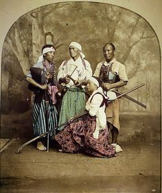 Samurai martial arts practitioners, the one in front is holding a naginata.