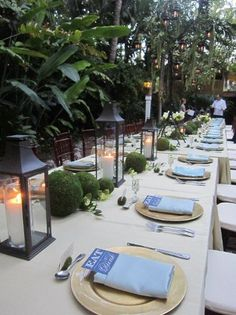 Love the idea of large tall lanterns on a table......